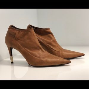 Tan Gucci Booties with Gold Heel Detailing